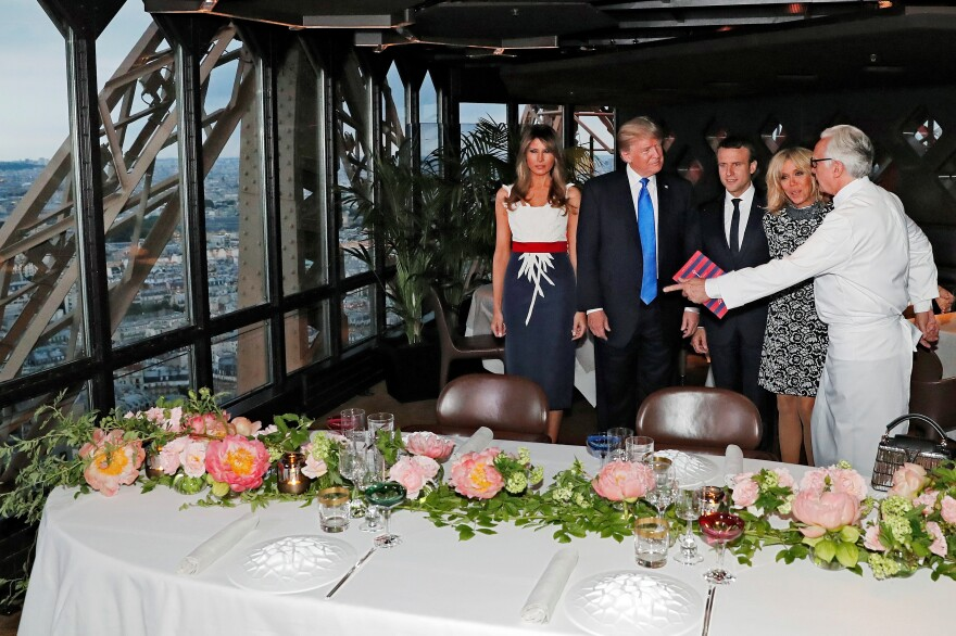 "French President Emmanuel Macron and his wife, Brigitte, dined with President Trump and first lady Melania Trump in the Eiffel Tower in July 2017. Trump later called it ""one of the most beautiful evenings you'll ever see. So that was a great honor."""