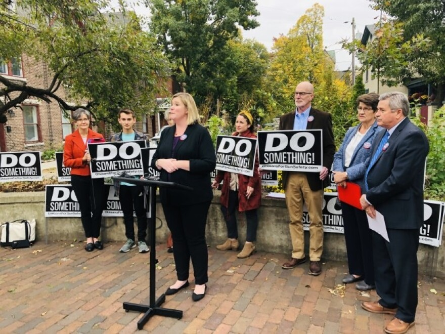 """Do Something!"" was a popular gun reform slogan after the mass shooting in Dayton. Here, Dayton Mayor Nan Whaley, State Senator Peggy Lehner, and Montgomery County Auditor Karl Keith speak at a press conference."