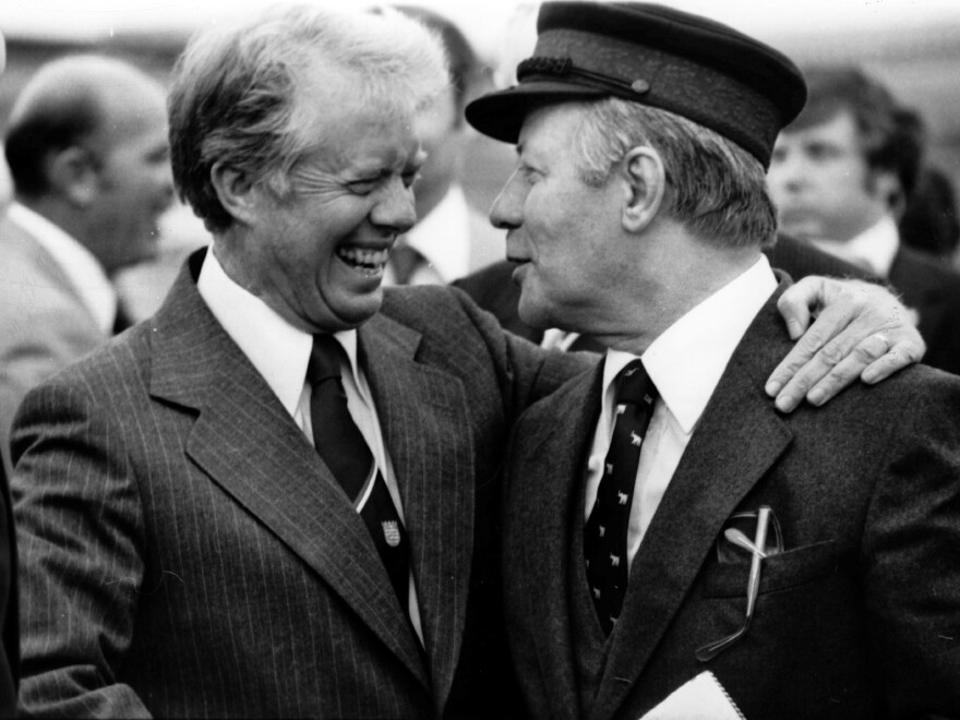 President Jimmy Carter and West German Chancellor Helmut Schmidt prepare to depart Berlin in July 1978. Although Schmidt spoke English well, he needed an interpreter's help when he was tired.