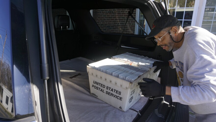 Stan Hale removes boxes of newspapers fresh from the printer in preparation for folding, labeling and mailing.