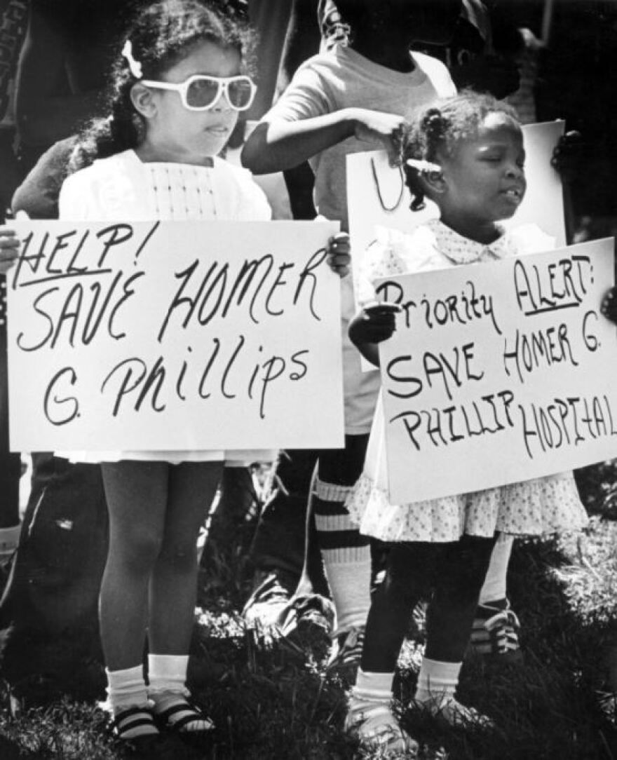 On August 17, 1980, Jolene Cotton (4) and Tiffany Hudson (2), join the ranks of demonstrators in a march that marked the one year closing of Homer G. Phillips Hospital. Photograph by John Dengler for the St. Louis Globe-Democrat.