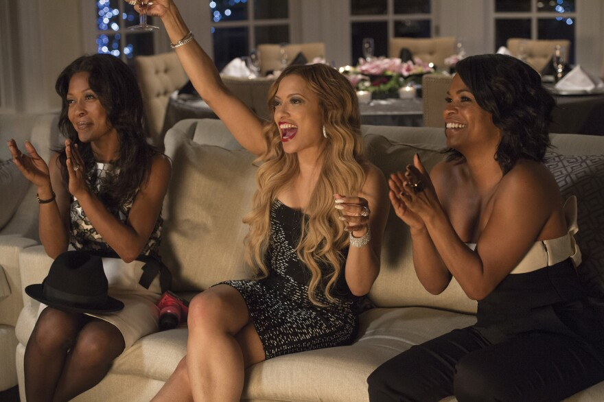 Monica Calhoun (left), Melissa De Sousa and Nia Long star in <em>The Best Man Holiday</em>, one of this year's eleven top-grossing films starring black actors and by black directors.