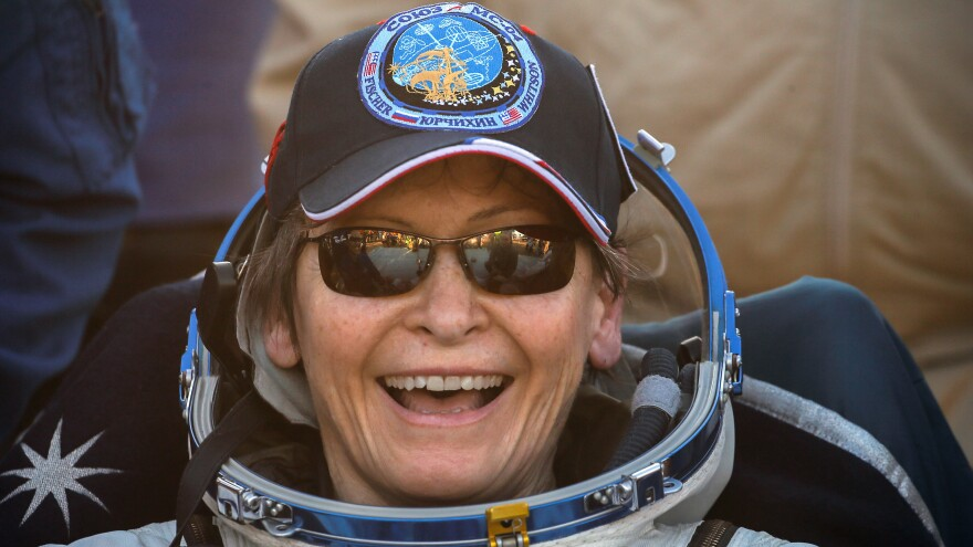 Astronaut Peggy Whitson smiles after landing in Kazakhstan, wrapping up a record 665 days in space for an American.