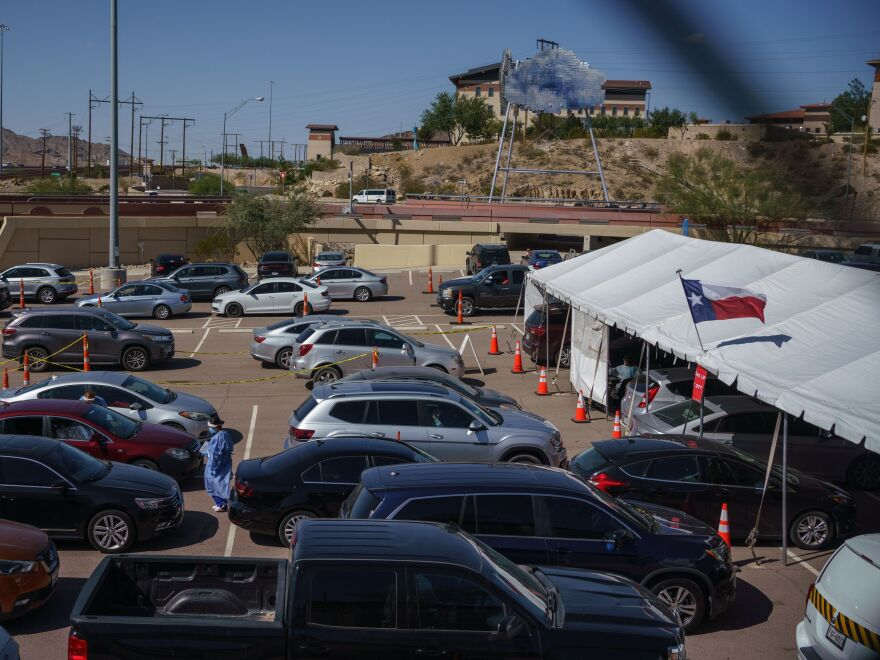 Cars line up for coronavirus tests at the University of Texas at El Paso on October 23. The city has seen a surge in cases which prompted a judge to issue a shutdown of non-essential businesses.