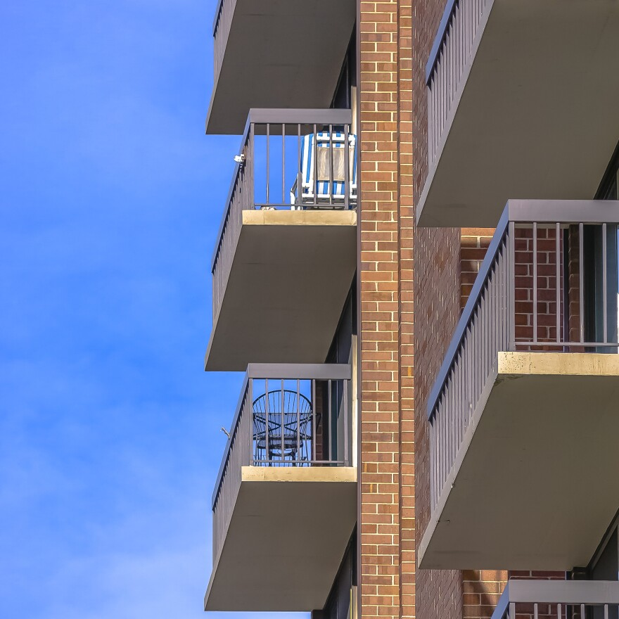 Photo of balconies on a red brick apartment building