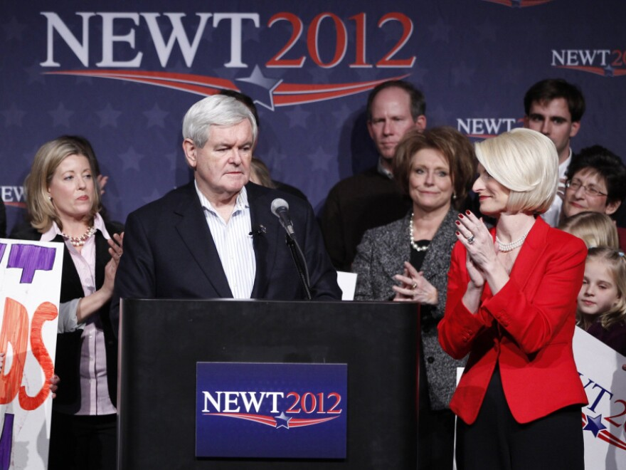 Former House Speaker Newt Gingrich appeared with wife Callista (right) at his Iowa caucus night rally in Des Moines.