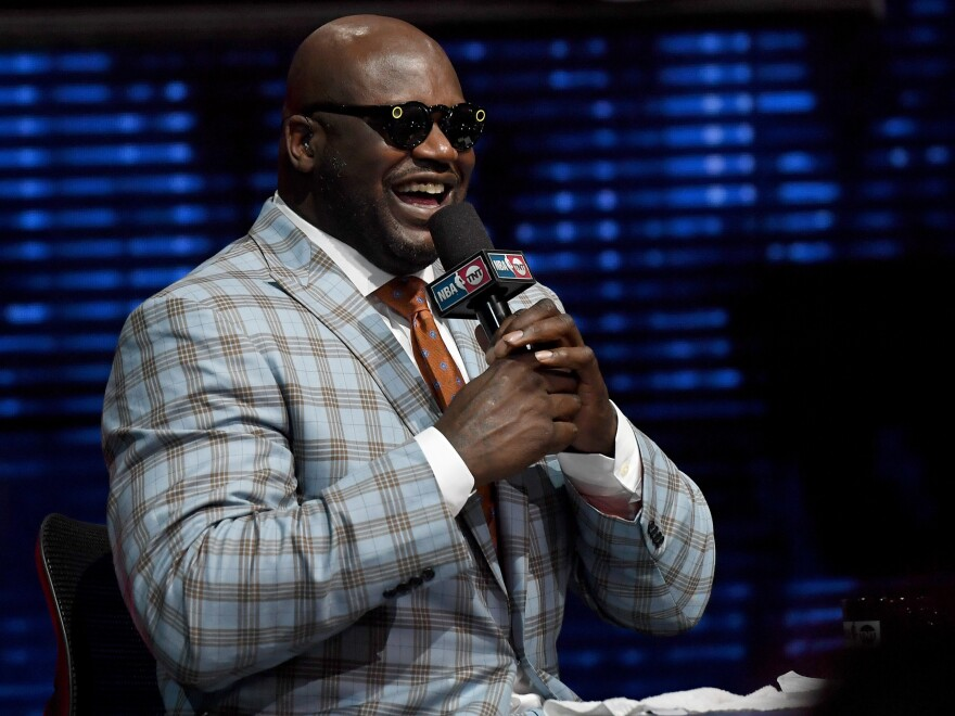 Shaquille O'Neal laughs as he tries a pair of Snapchat Spectacles during CES on January 5, 2017 in Las Vegas, Nv.