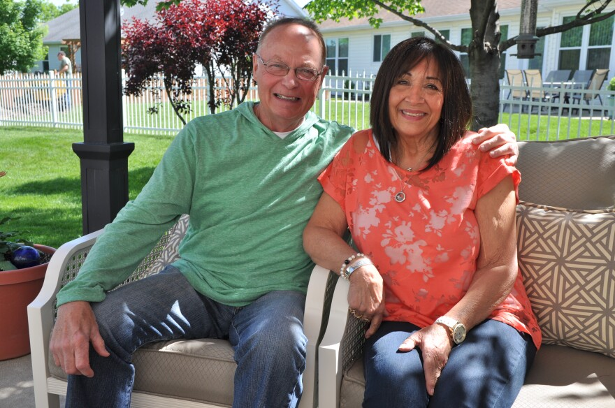 Bob and Jodi Malon, in their backyard in St. Peters. Bob, who was diagnosed with colon cancer in 2004, is the lead plaintiff for the case.