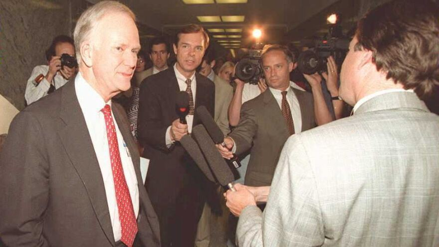 Sen. Bob Packwood is surrounded by members of the media on Capitol Hill on May 18, 1995.