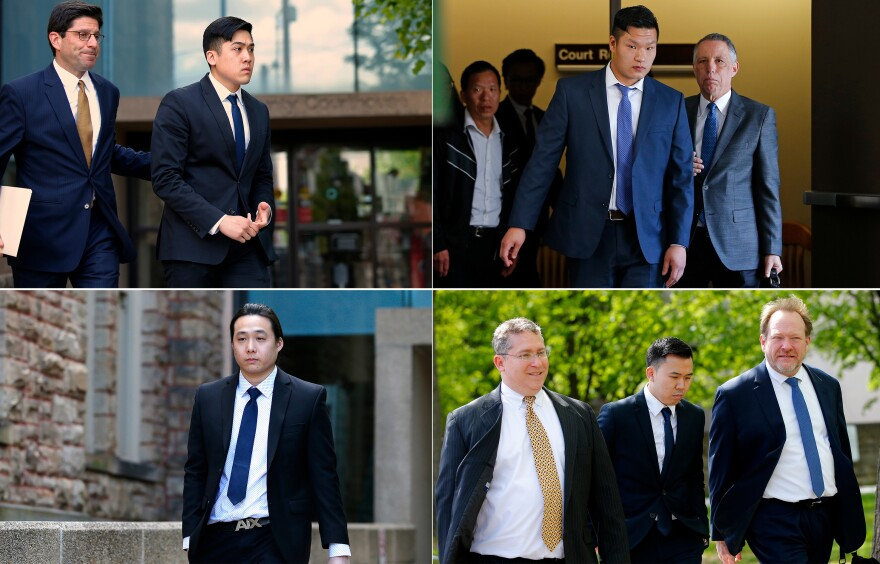 Sheldon Wong (clockwise from top left), Raymond Lam, Kenny Kwan and Charles Lai leave the Monroe County Courthouse in Stroudsburg, Pa., in May 2017.