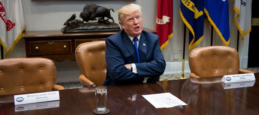 President Trump speaks to reporters next to the empty chairs for Senate Minority Leader Chuck Schumer, D-N.Y., and House Minority Leader Nancy Pelosi, D-Calif.. The Democrats declined to attend a meeting with Trump and Republican leaders at the White House on Tuesday.