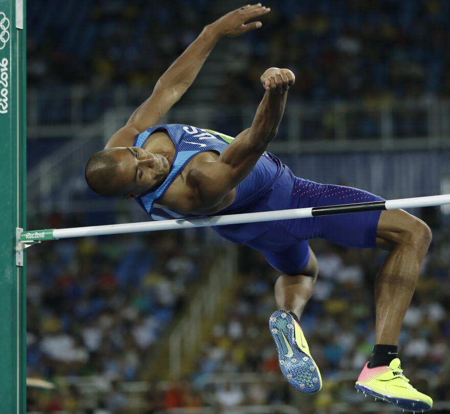 American Ashton Eaton competes in the high jump on Wednesday, the first day of the two-day, 10-event decathlon in Rio. Eaton is the reigning Olympic champion and world record holder and was in first place heading into the final five events on Thursday.