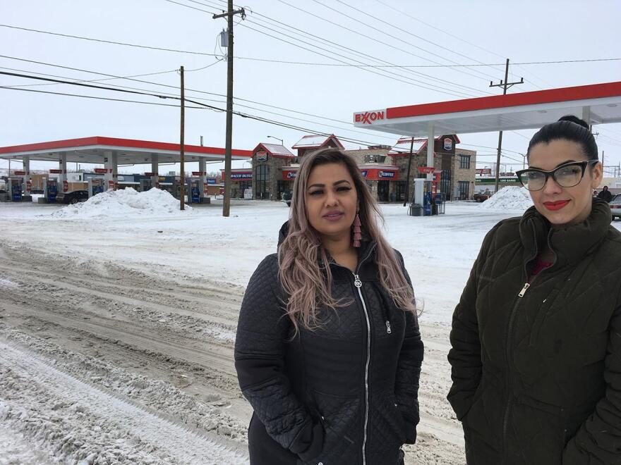 Martha Hernandez (left) and Ana Suda standing outside a gas station in Havre.