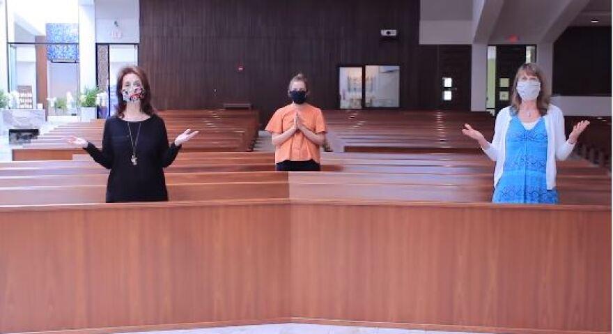 Catholic church parishioners wearing masks in service
