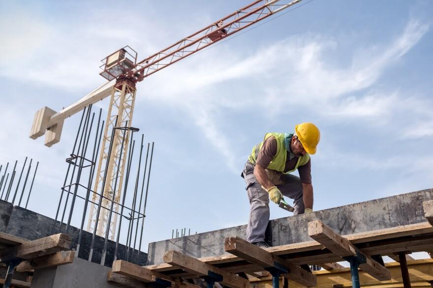 Man working on scaffolding.