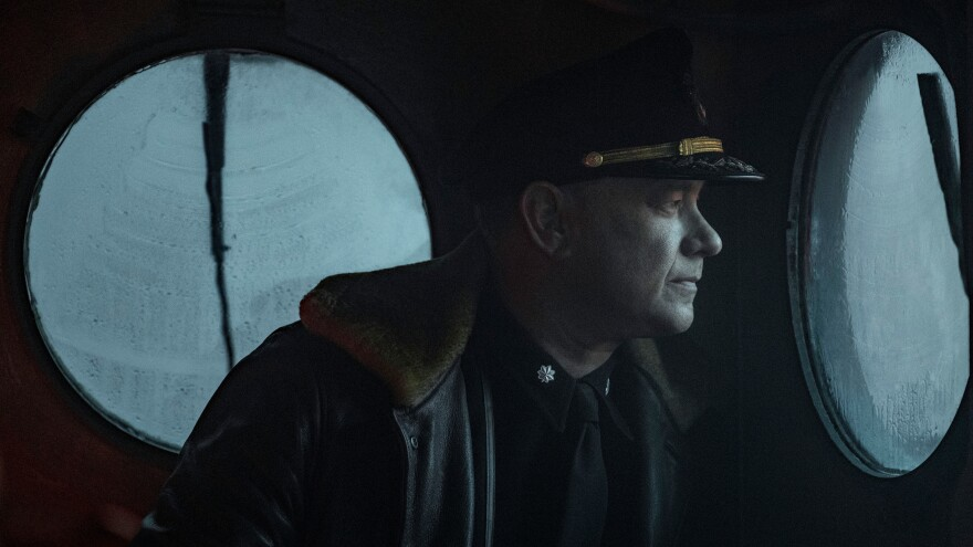 Captain Krause (Tom Hanks) looks astern in <em>Greyhound</em>.
