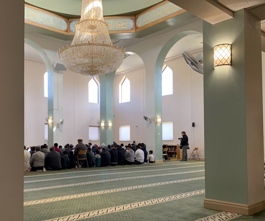 Worshippers take part in Friday prayer at the Daar Ul-Islam Mosque in Manchester on March 15.