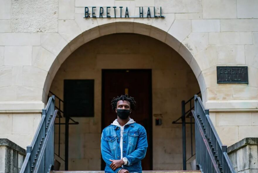 Evan Bookman stands outside of Beretta Hall on the campus of Texas State University. The building is named named after Sally Beretta, a Daughter of the Confederacy.