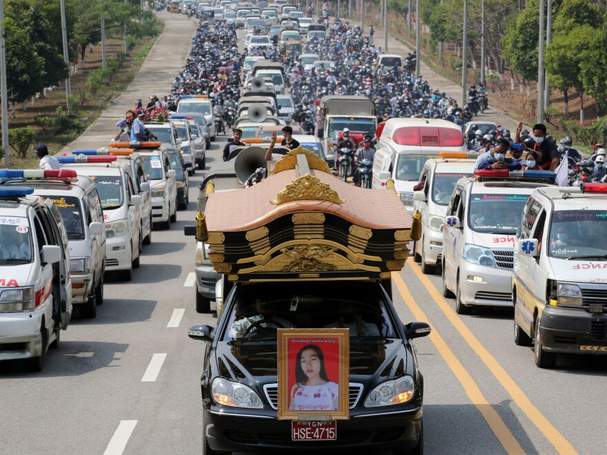 A car carrying the body of protester Mya Thwet Thwet Khine is pictured at the head of a convoy during her funeral service Sunday in Naypyitaw. She was the first confirmed fatality in the ongoing protests against the military coup.