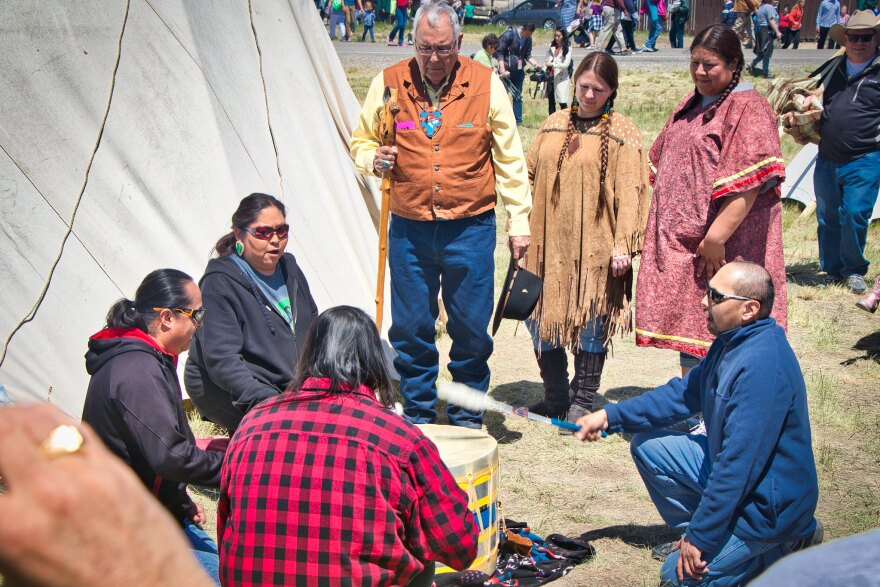 Native American community members drumming.