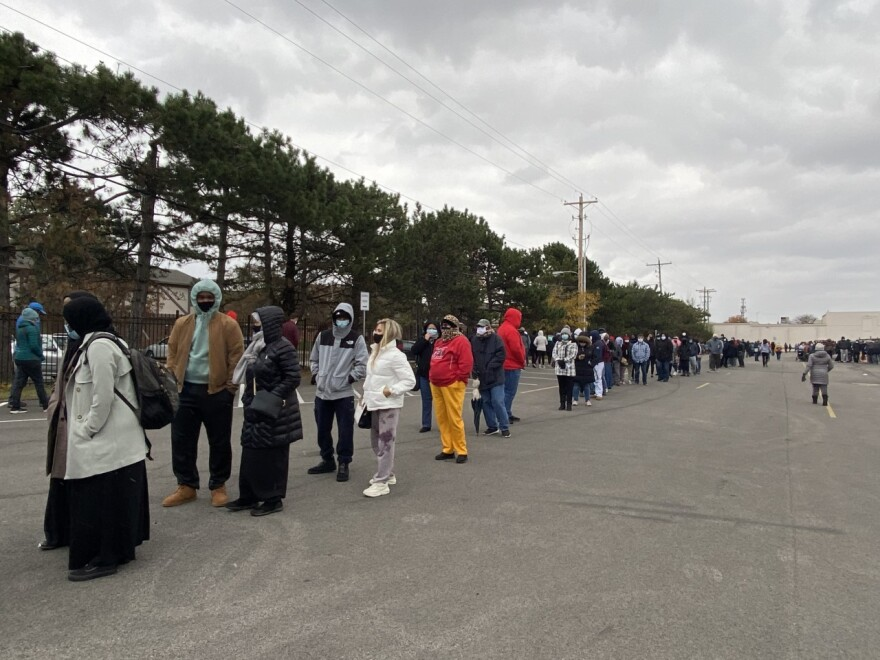 The line at the Franklin County Board of Elections in Columbus stretched the length of the shopping center where the early vote center is located, and snaked back and forth behind the building.