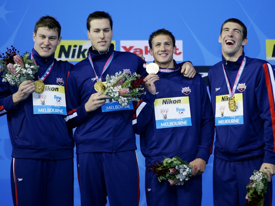 The USA Men's 4x200m Freestyle relay team members, from left, Peter Vanderkaay, Klete Keller, Ryan Lochte and Michael Phelps celebrate after winning the gold medal at the World Swimming Championships in Melbourne, Australia in 2007.