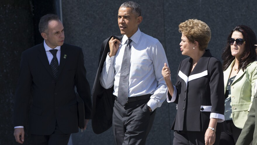 President Barack Obama walks with Brazilian President Dilma Rousseff, second from right, during a visit to the Martin Luther King Jr. Memorial in Washington, D.C., on Monday.