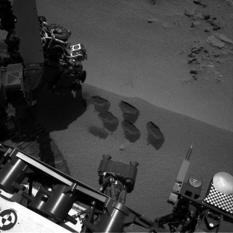 """NASA's Mars rover Curiosity dug up five scoops of sand from a patch nicknamed """"Rocknest."""" A suite of instruments called SAM analyzed Martian soil samples, but the findings have not yet been released."""