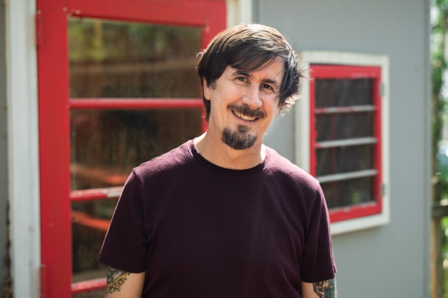 The Mountain Goats' John Darnielle at his home in Durham, N.C., where he wrote and recorded <em>Songs for Pierre Chuvin</em> in 10 days.