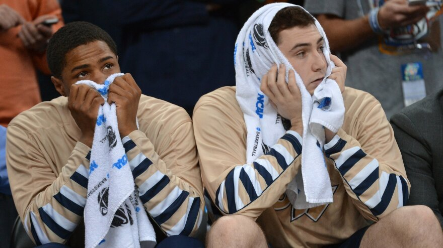 George Washington University players were dejected Friday as they went down in defeat to Memphis. The team's loss also wiped out any chance for someone to win $1 billion from Quicken Loans and Warren Buffett.