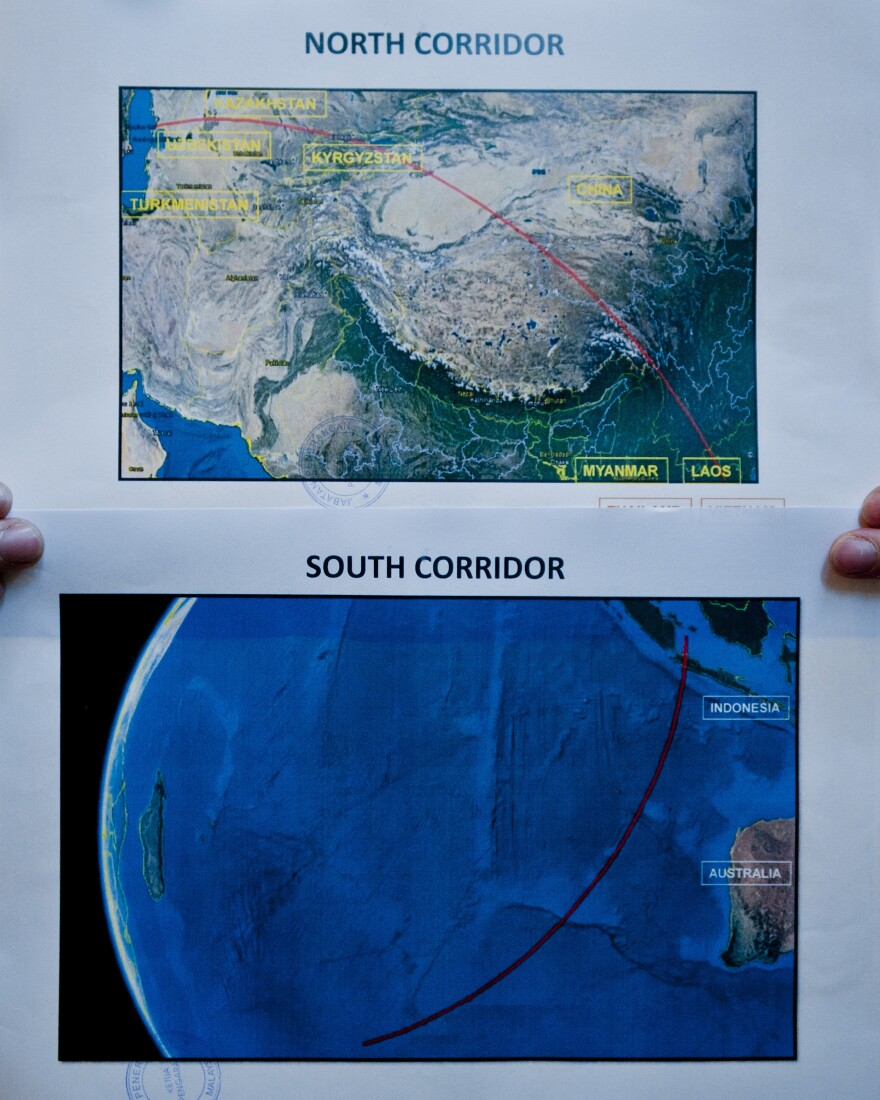 Two satellite maps of the possible location of the missing Malaysia Airlines Flight MH 370 are seen at a news conference in Kuala Lumpur, Malaysia, on Monday.