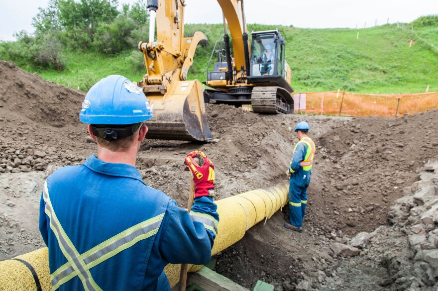 TransCanada workers doing maintenance work on a natural gas pipeline.