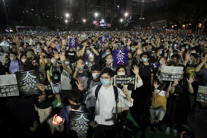 "After Hong Kong's huge pro-democracy demonstrations in 2019, the Chinese government imposed a new security law this year. Still, protests continued. At a June 4 vigil for victims of the 1989 Tiananmen Square massacre, demonstrators gesture with five fingers, signifying ""five demands — not one less,"" and hold posters reading ""Heaven will destroy the CCP,"" referring to the Chinese Communist Party."