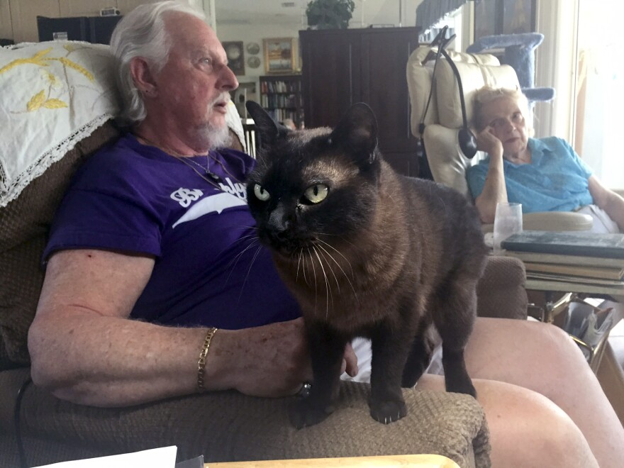 Nelson Jantzen and his present wife, Irene, have two Burmese cats. Nelson's love of cats inspired his cremation jewelry design.