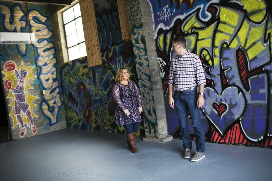 Tara DeFrancisco and Rance Rizzutto walk around their new comedy space in downtown Columbus. The newlyweds are recent transplants from Chicago and are opening a comedy theater.