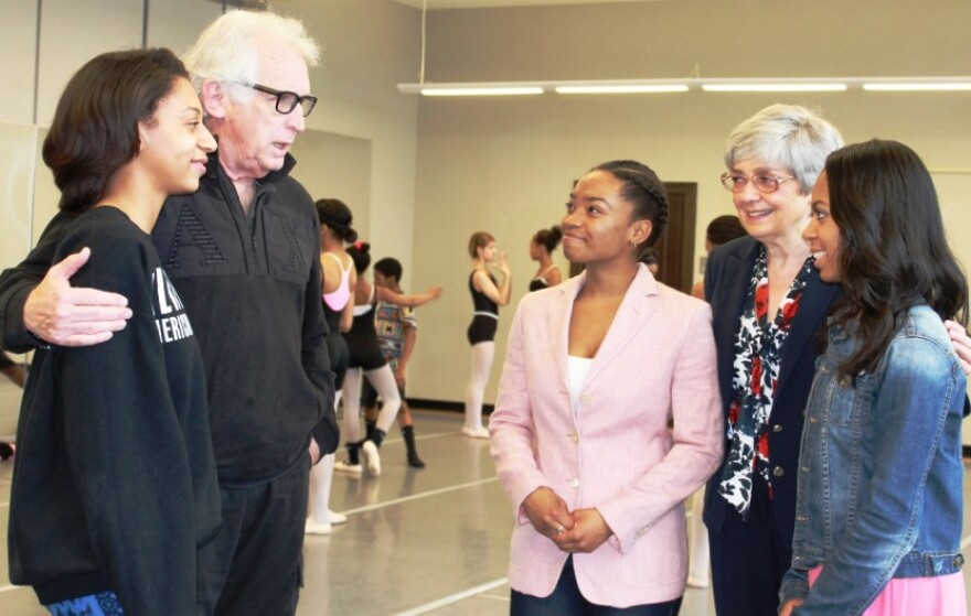 Michael Uthoff, second from left, talks with students, along with Dance St. Louis' Janet Brown. (Brown is in the middle on the right-hand side of the photo).
