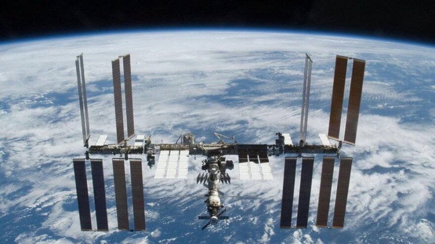 The International Space Station as seen from the space shuttle Atlantis after it undocked from the outpost in November 2009. Despite an end to the space shuttle program, NASA says scientific work is just getting into full gear on the space station.