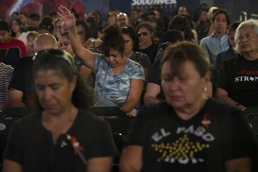 A moment of prayer during Wednesday night's community memorial service at Southwest University Park in El Paso, Texas.