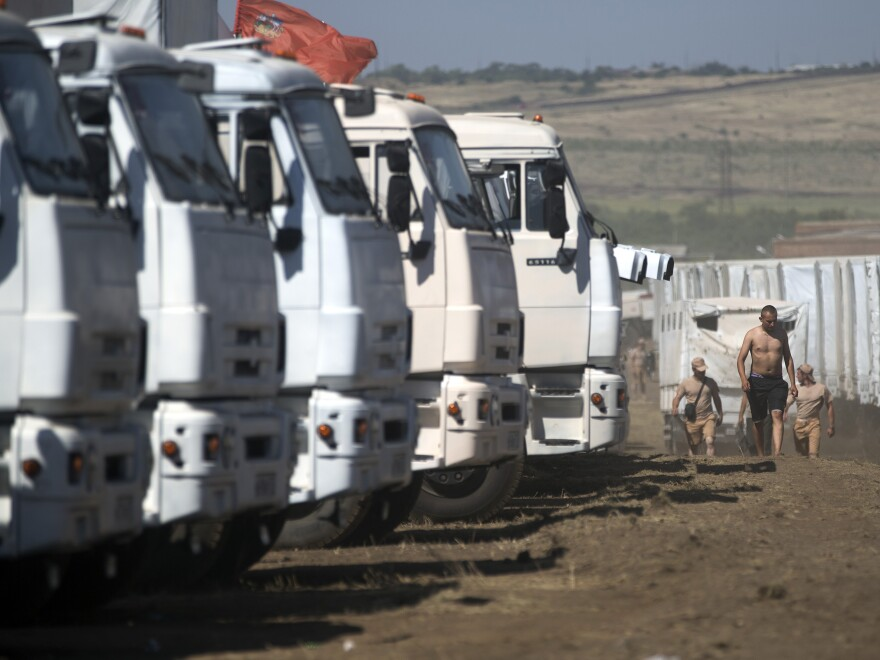 A convoy purportedly carrying humanitarian aid is parked about 17 miles from the Ukrainian border, Rostov-on-Don region, Russia, on Friday. Ukrainian officials have insisted on inspecting the cargo over fears that the convoy might be a pretext for invasion.