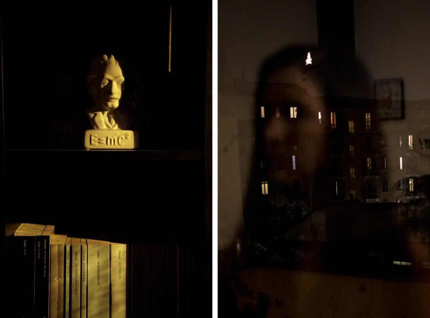Left: An Albert Einstein bust and bookshelf in the living room glow under the lamp light. Right: Self-portrait reflected in the window at night. It's unusual to see so many lights on.