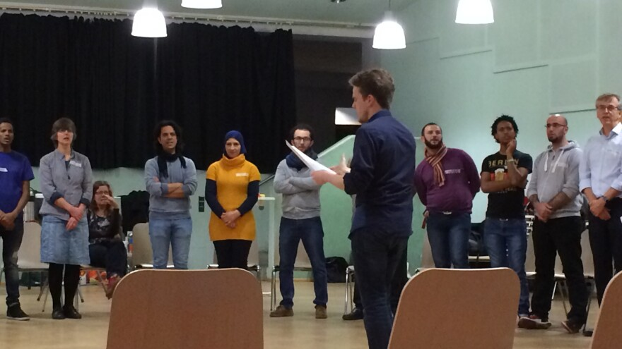 Members of Berlin's recently formed <em>Begegnungschor </em>Choir (Getting To Know You Choir) rehearse. The 50-person choir is made up equally of Germans and asylum seekers, who are from Syria and Eritrea.
