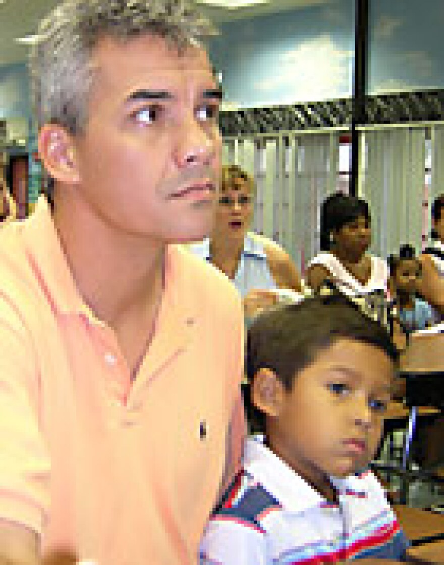 Back in 2004, Paul Marsenison, with young Sam at his side, listened intently during an orientation session for new parents .