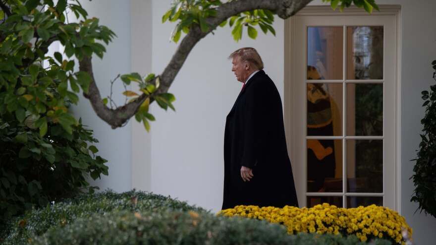 President Trump walks out of the Oval Office at the White House on Monday.