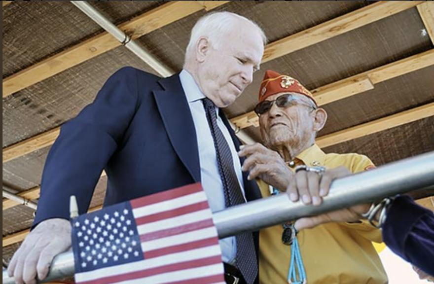 Sen. John McCain speaks with veteran.