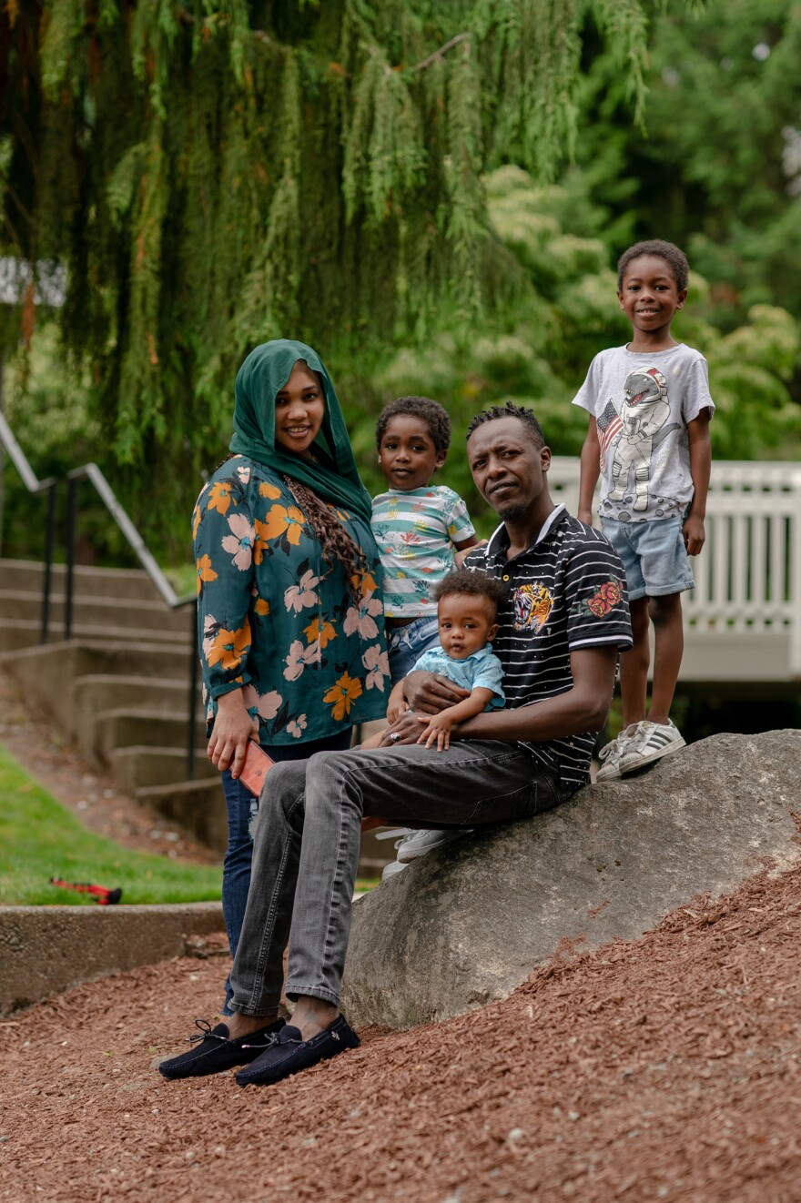 Samra Idris and her family stand near their home in Bellevue. They are part of the Creating Moves to Opportunity project. In their previous home, her older son did not want to go to school because he was routinely hit on the bus. Now, he can't wait to go to school.