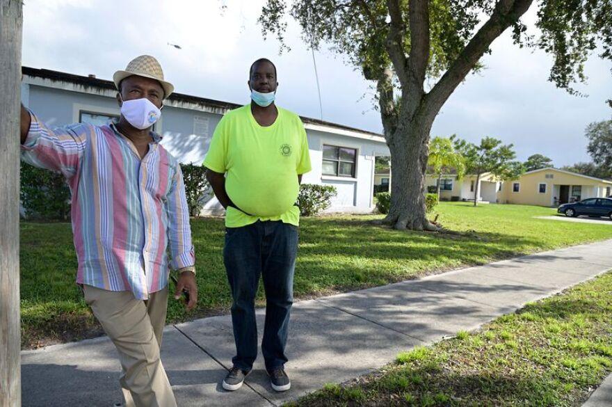 Two men wearing masks