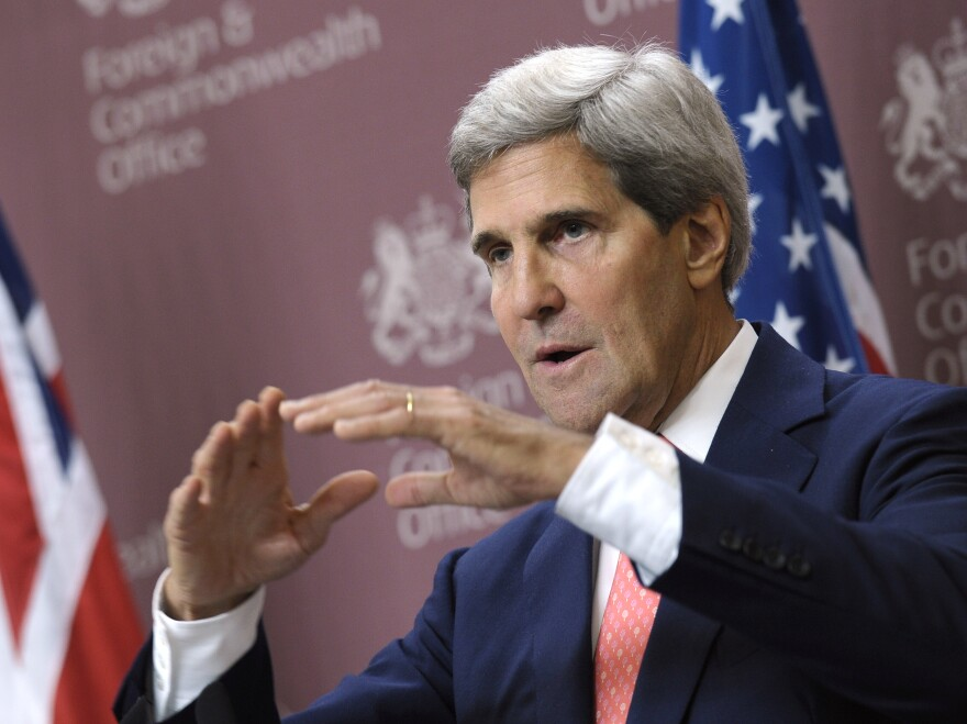 Secretary of State John Kerry speaks during a news conference Monday in London.