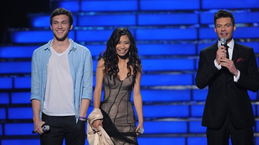 <em>American Idol</em> finalists Phillip Phillips and Jessica Sanchez on stage with host Ryan Seacrest on the Fox TV show Tuesday night.