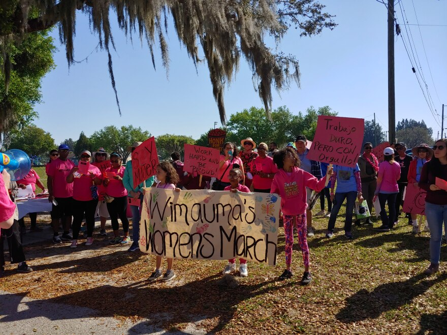 Dozens march in Wimauma, Florida, to celebrate Women's History Month and the contributions of women farmworkers on March 23.