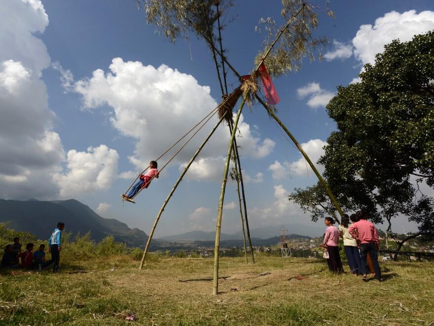 "Would you like to swing on a ""Dashain Ping""? Towering rough-hewn swings are erected for the Hindu festival."